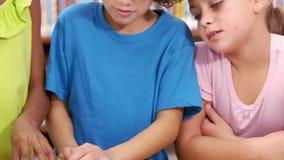 Cute schoolchildren reading in their classroom. In elementary school stock video