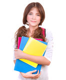 Cute schoolgirl with colorful books Royalty Free Stock Images