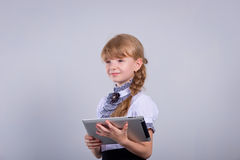 Cute schoolgirl with a laptop Royalty Free Stock Photography