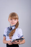 Cute schoolgirl with a laptop Royalty Free Stock Images