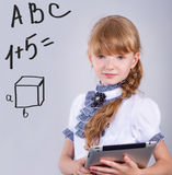 Cute schoolgirl with a laptop Royalty Free Stock Photos