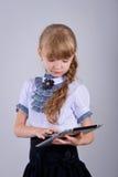 Cute schoolgirl with a laptop Stock Photos