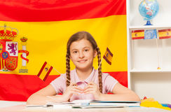 Cute schoolgirl learning Spanish at the classroom Royalty Free Stock Photos