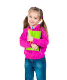 Cute schoolgirl with notebook Royalty Free Stock Photo