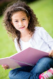 Cute schoolgirl at the park Stock Image