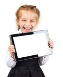Cute schoolgirl with a pc tablet Stock Photo