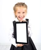 Cute schoolgirl with a pc tablet Royalty Free Stock Images