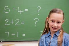 Cute schoolgirl posing Stock Image