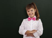 Cute schoolgirl Stock Images