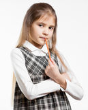 Cute schoolgirl posing with pencil against white background Royalty Free Stock Photography