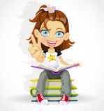 Cute schoolgirl read on a pile of books Stock Image