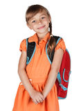 Cute schoolgirl with a red backpack on her shoulders Stock Photography