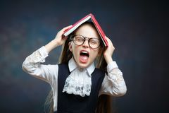 Free Cute Schoolgirl Shout Cover Head With Open Book Stock Photography - 139089622