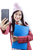 Cute schoolgirl taking self picture Royalty Free Stock Photos