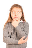 Cute schoolgirl thinking Stock Images