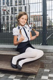Cute schoolgirl in uniform at playground Royalty Free Stock Images