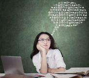Cute schoolgirl with web icons Stock Images