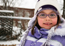 Cute schoolgirl on a winter day Royalty Free Stock Image
