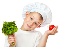 Cute scullion is holding fresh vegetables Royalty Free Stock Photography