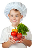 Cute scullion is holding fresh vegetables Stock Image