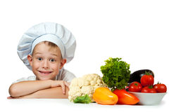 Cute scullion with raw vegetables Royalty Free Stock Photo