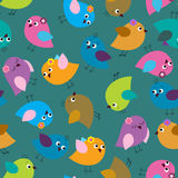 Cute seamless background with bright birds on a green background Royalty Free Stock Photo