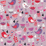 Cute seamless background. With flowers and birds in cartoon style Stock Photos