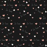 Cute seamless background with hearts and In love written words o. N black background. Saint Valentine`s Day. Vector Illustration Royalty Free Stock Photos