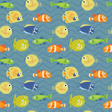 Cute seamless background with tropical fish on waves Royalty Free Stock Photos