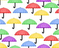Cute seamless background with umbrellas in red, yellow, green, purple and blue. Cheerful patterns for textile or wrapping paper. Vector EPS 10 royalty free illustration