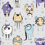 Cute seamless doodle pattern with lovely hand drawn monsters, dots and stars on grey background. Vector illustration with alien ma Royalty Free Stock Photography