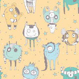 Cute seamless doodle pattern with lovely hand drawn monsters, dots and stars on yellow background. Vector illustration with alien Stock Image