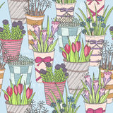 Cute seamless floral pattern. Pattern with flowers in buckets. Royalty Free Stock Photography