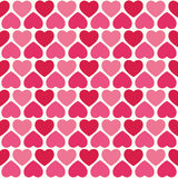 Cute seamless hearts pattern in pink and red Stock Photos