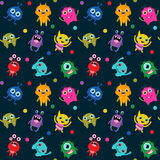 Cute seamless pattern with alien monsters. In different colors on dark background for children clothes Stock Photo