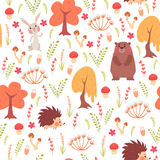 Cute seamless pattern with animals in forest Stock Photos