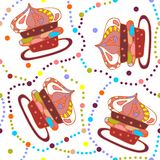 Cute seamless pattern with bright cupcakes and colorful dots. Royalty Free Stock Photography