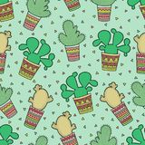 Cute seamless pattern with cactuses in the Mexican style. Cute seamless pattern with cactuses in the Mexican style on the green background Royalty Free Stock Photography