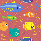 Cute seamless pattern with cartoon fish on a pink background Stock Photo