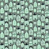 Cute seamless pattern with cartoon houses Stock Photos