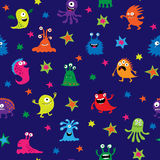 Cute seamless pattern with cartoon monsters on a blue background. Cute seamless pattern with a cartoon monsters on a blue background vector illustration