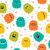 Cute seamless pattern with cartoon smiley monsters. Different fl Royalty Free Stock Photo