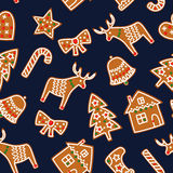 Cute Seamless pattern with Christmas gingerbread cookies - xmas tree, candy cane, bell, sock, star, house, bow, heart, deer. Cute. Winter holiday background Royalty Free Stock Photo