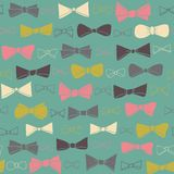 Cute seamless pattern of colored bows on green background. Royalty Free Stock Photo