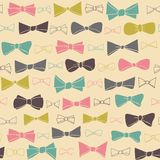 Cute seamless pattern of colored bows on a pastel  background. Royalty Free Stock Photography