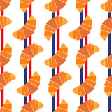 Cute seamless pattern with croissants and colors of french flag stripes. Stock Photos