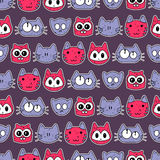 Cute seamless pattern with cute cat faces Stock Photos