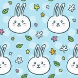 Cute seamless pattern with doodle rabbits and flowers Stock Photo