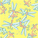 Cute seamless pattern with dragonflies hand drawn in vector on yellow background.  Stock Image