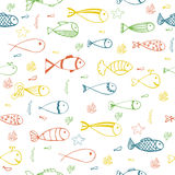 Cute seamless pattern with fishes, starfish and corals Royalty Free Stock Image